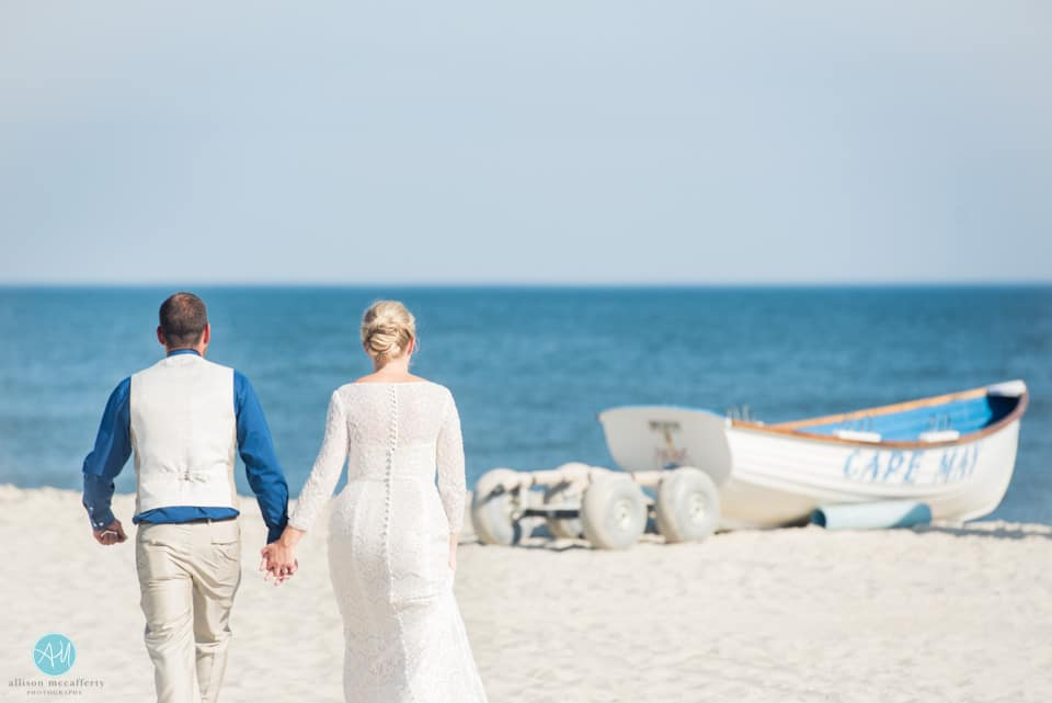 Long sleeves on the beach! Not one complaint from this gorgeous bride.