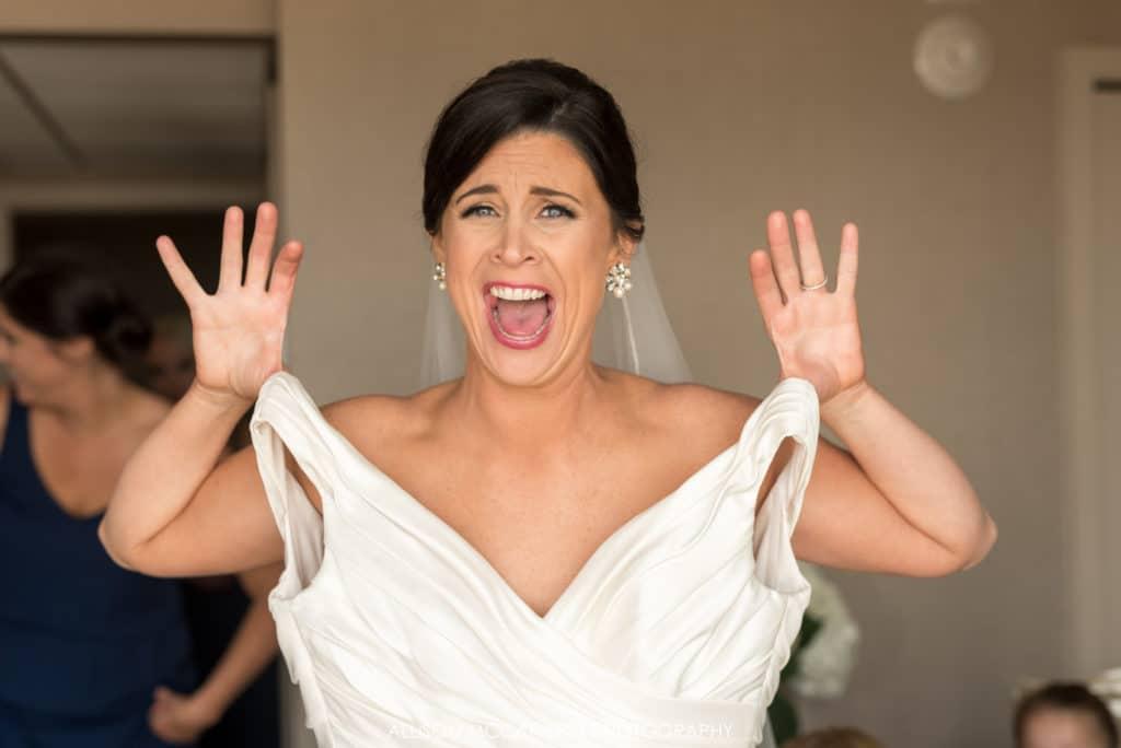 Excited bride getting dressed