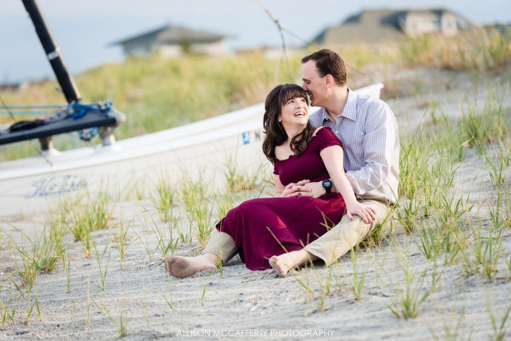 Engagement photos by boats in Ocean City NJ