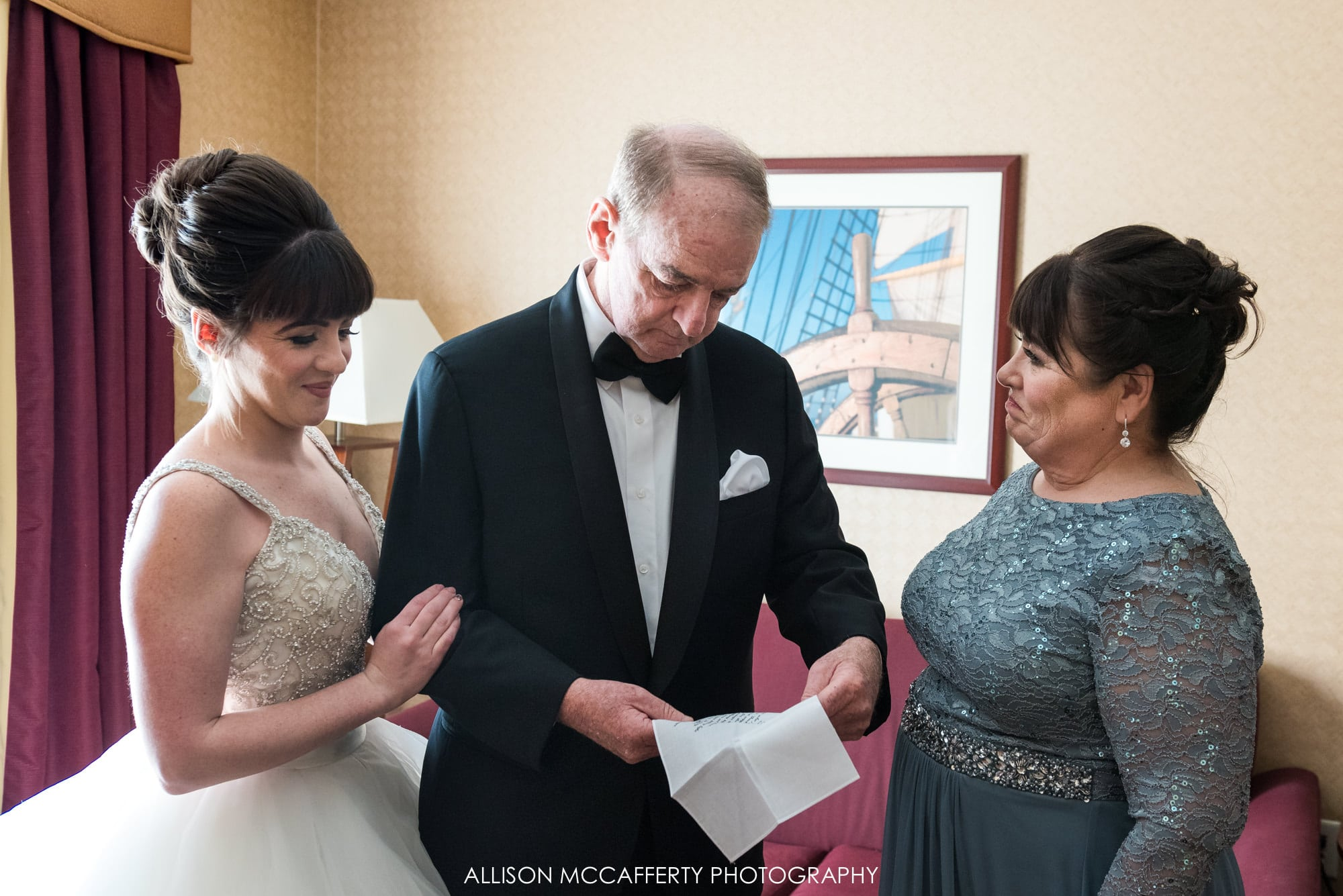 Bride giving her parents a gift before the wedding