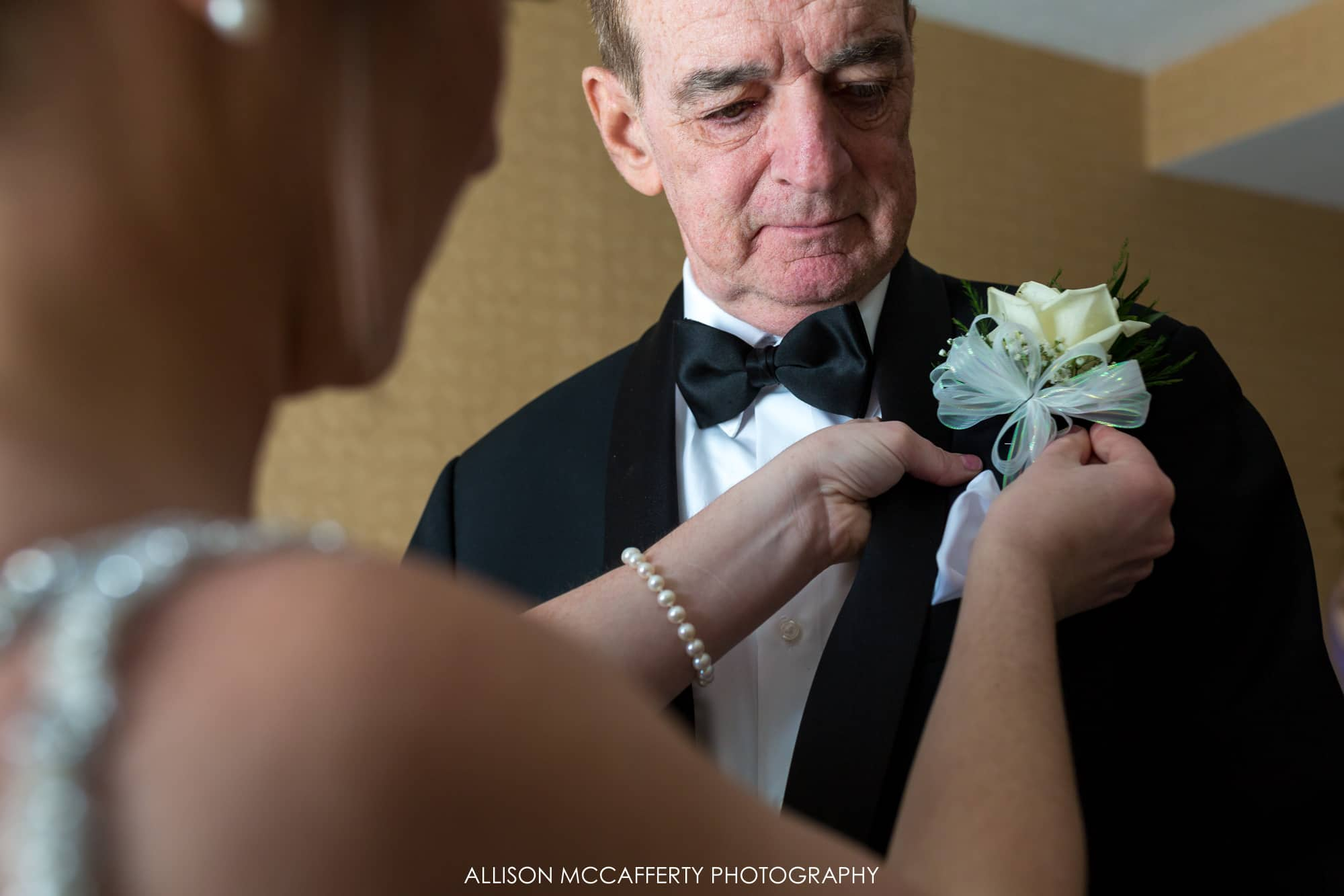 Bride giving her Dad a boutonniere