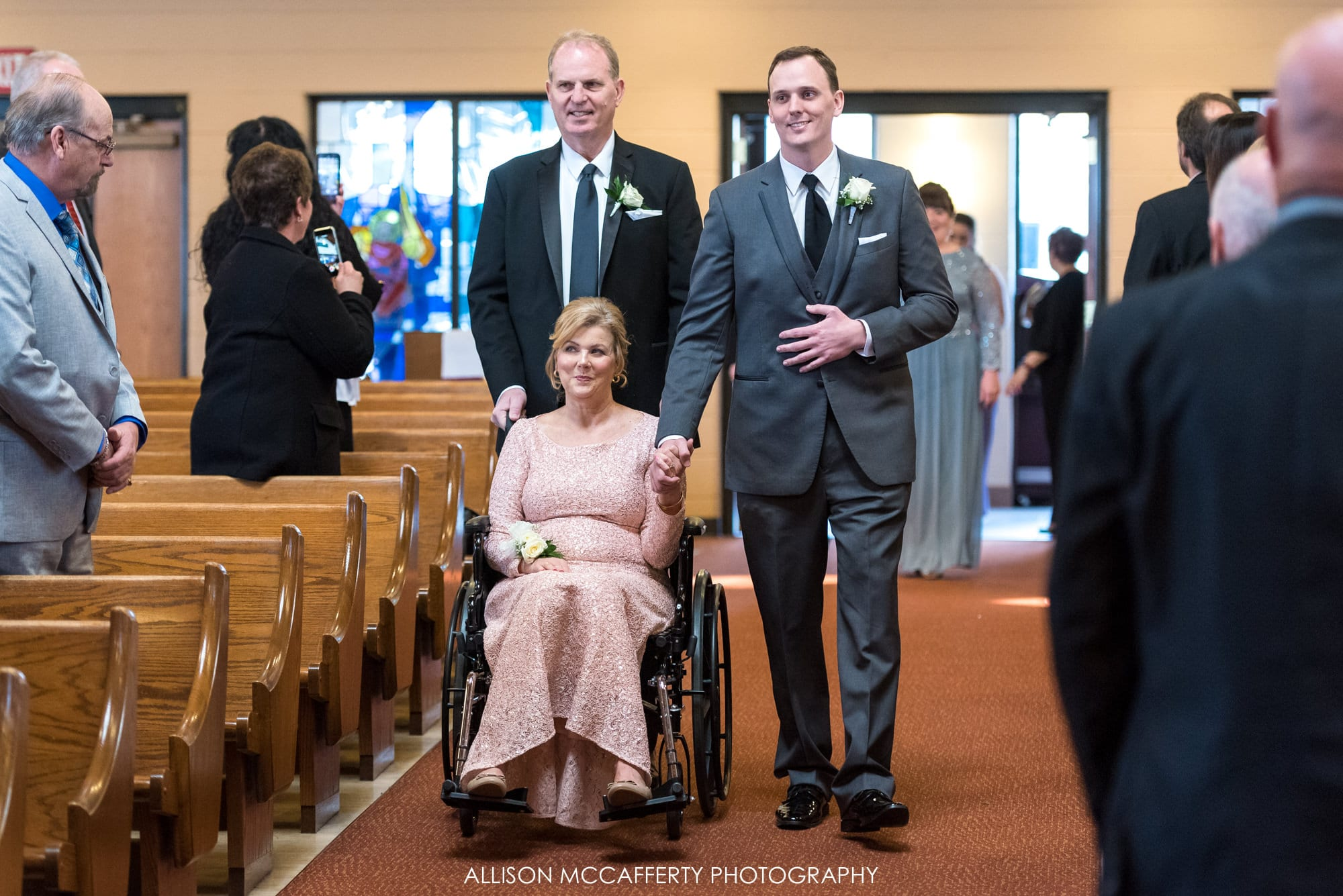 Groom and his Dad walking his Mom down the aisle for his wedding