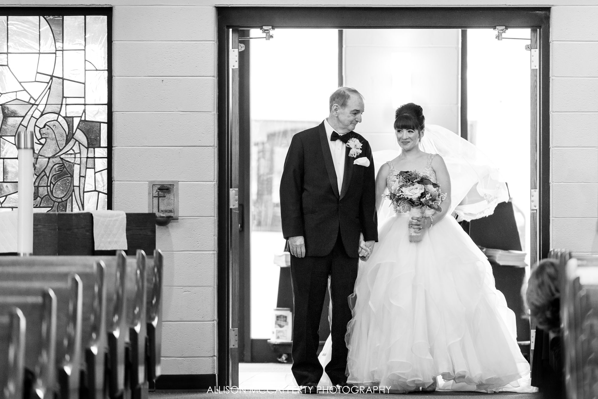 Black and White photo of the bride and her dad getting ready to walk down the aisle