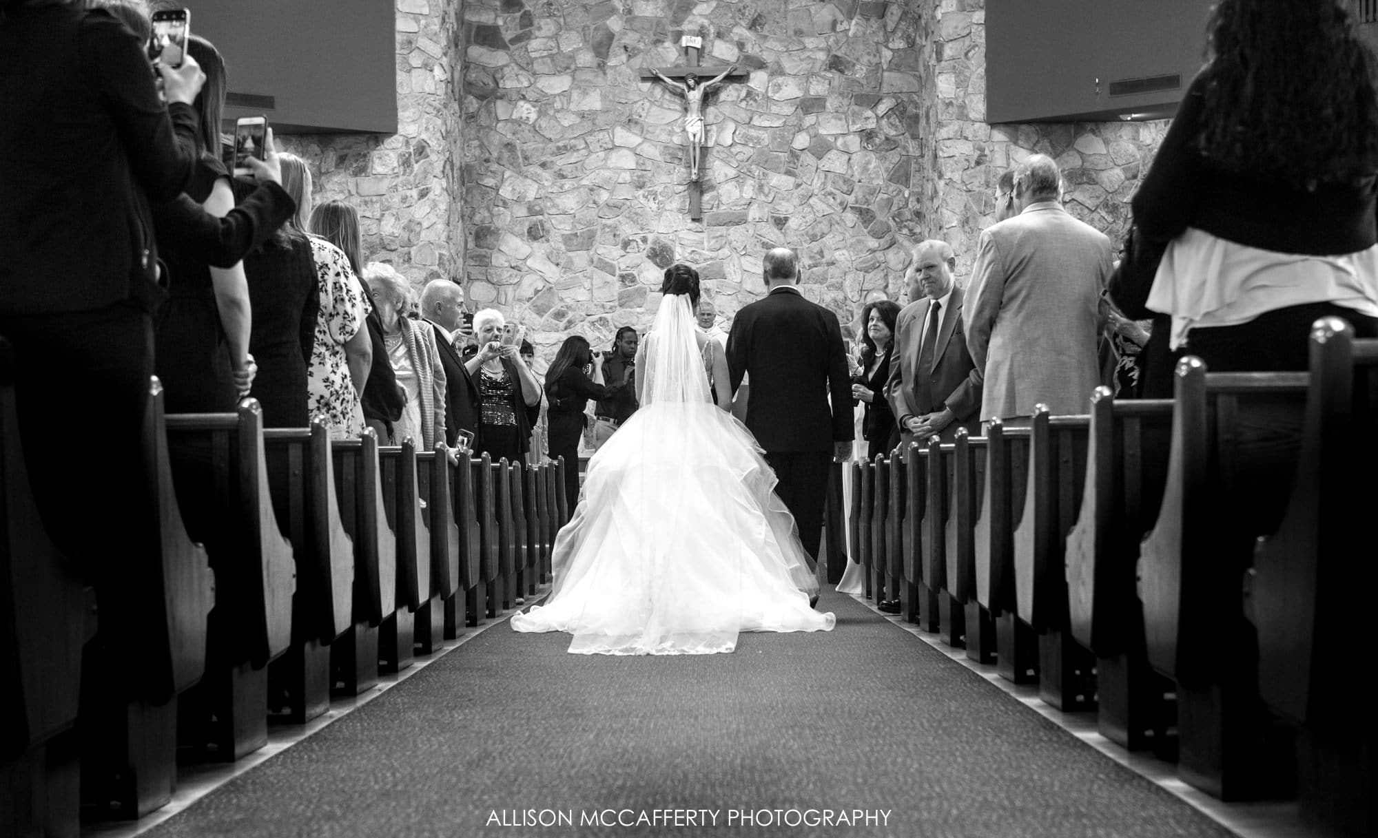 Black and white photo of the church during a wedding