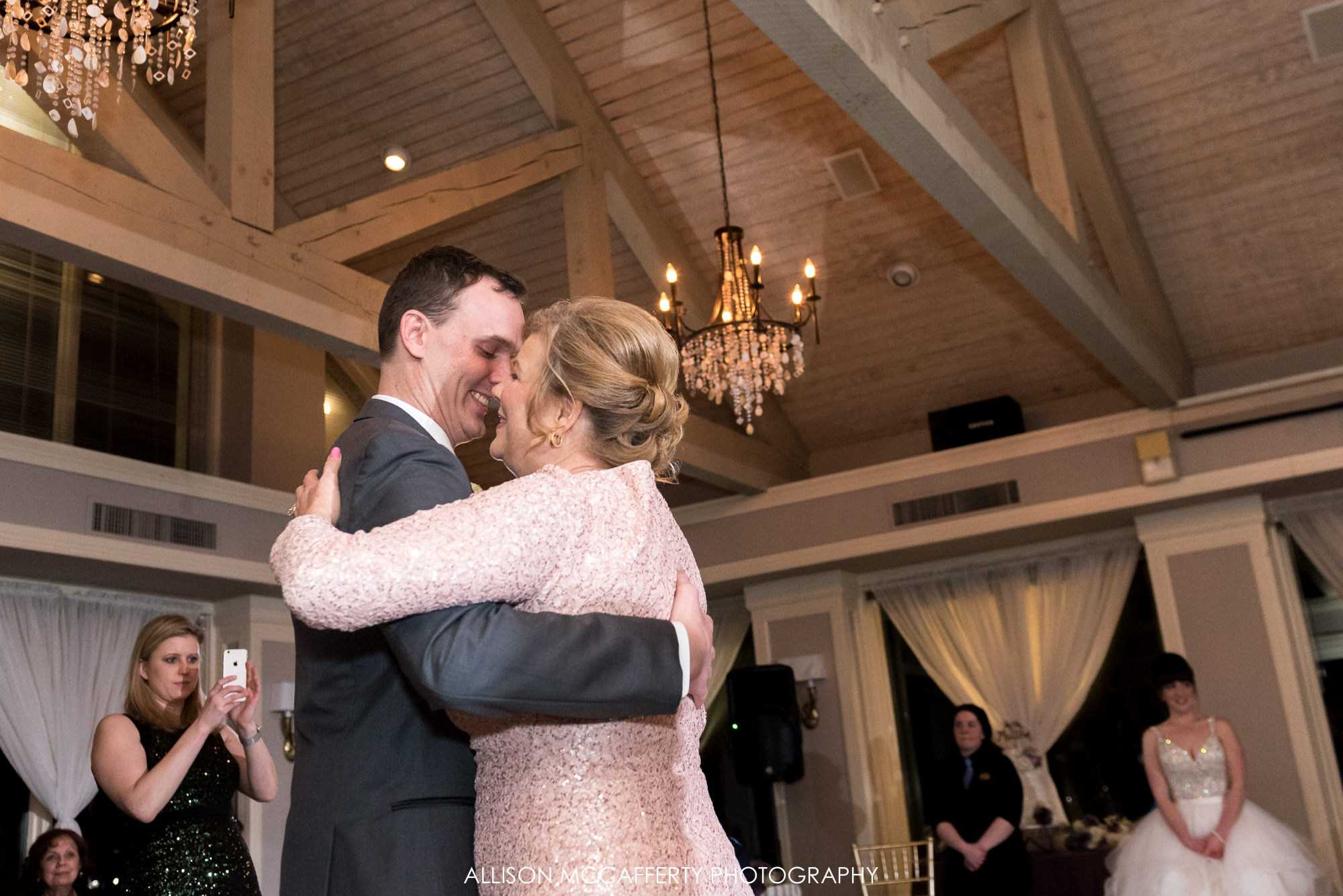 Groom dancing with his Mom at his wedding