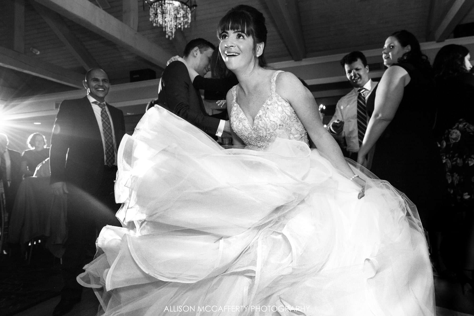 Black and white photo of bride dancing on the dance floor with a big dress Blue Heron Pines Wedding cost