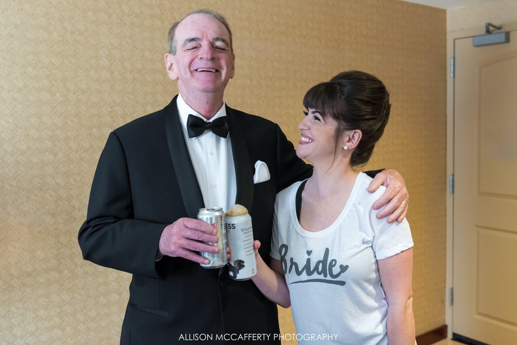 Bride and her Dad having a beer before the wedding