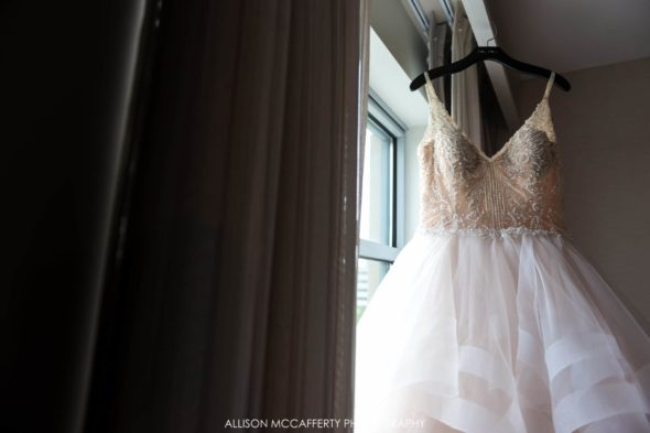 Wedding gown hanging in the window