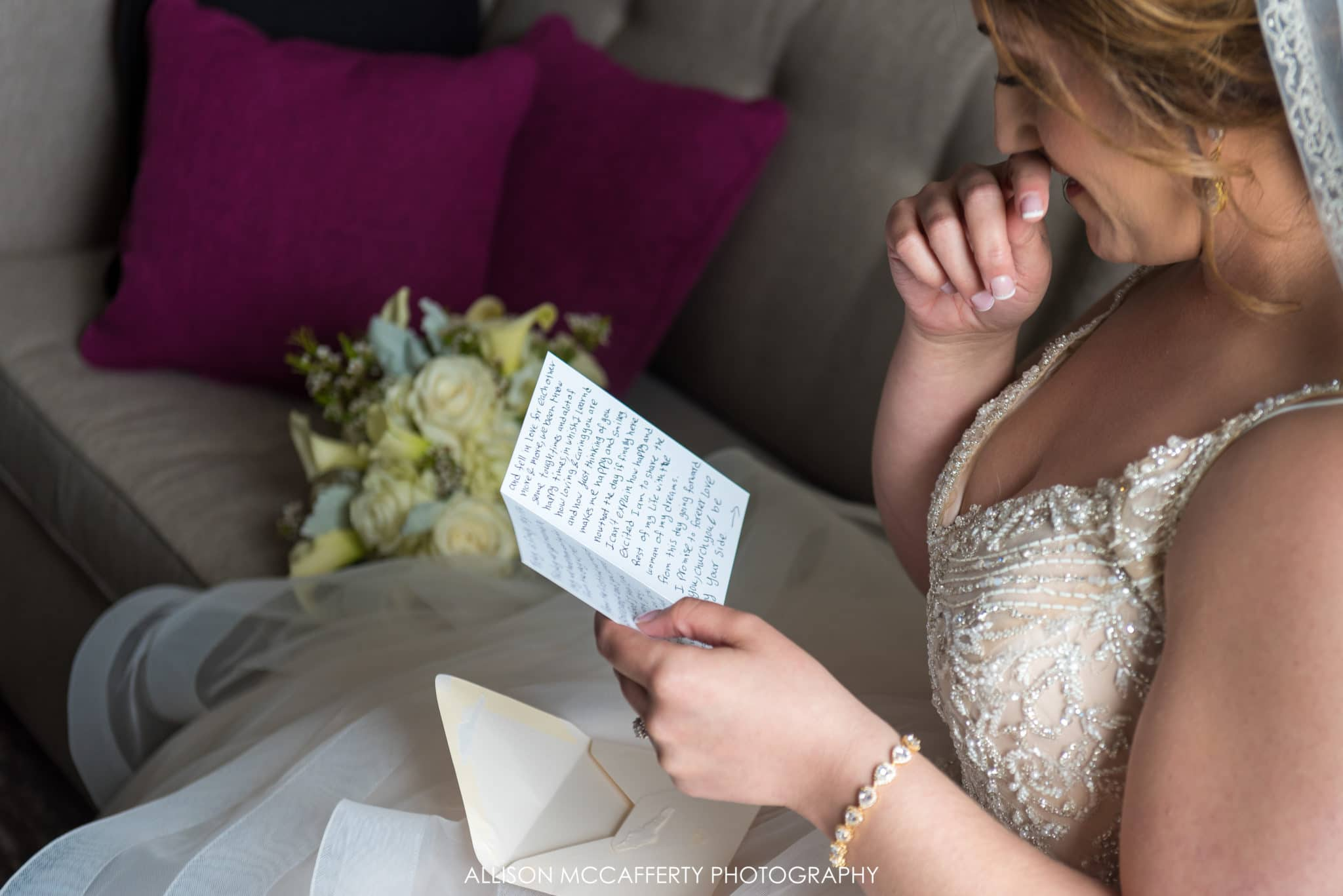 bride reading card from her groom