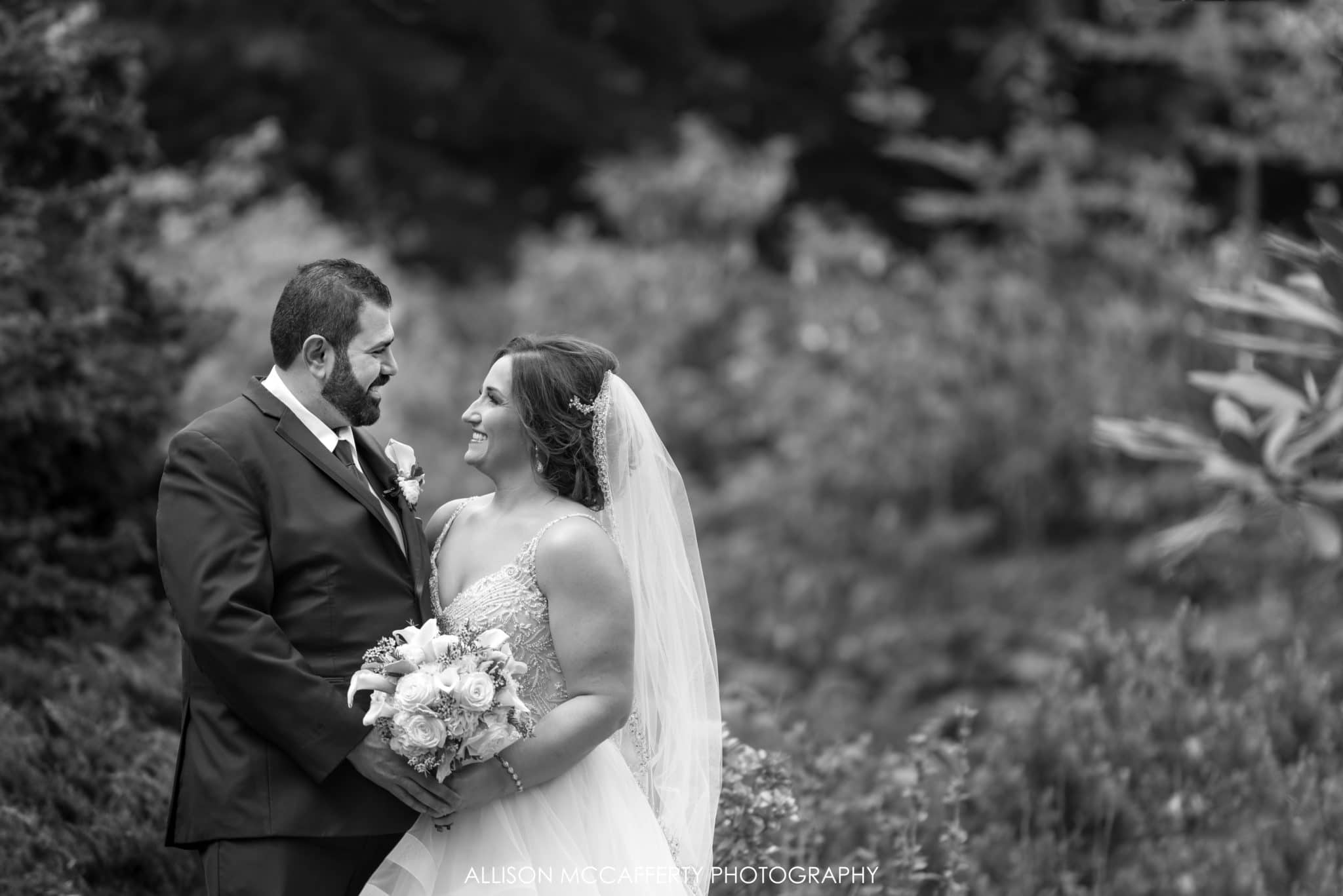 black and white portrait of wedding at Reeves-Reed Arboretum