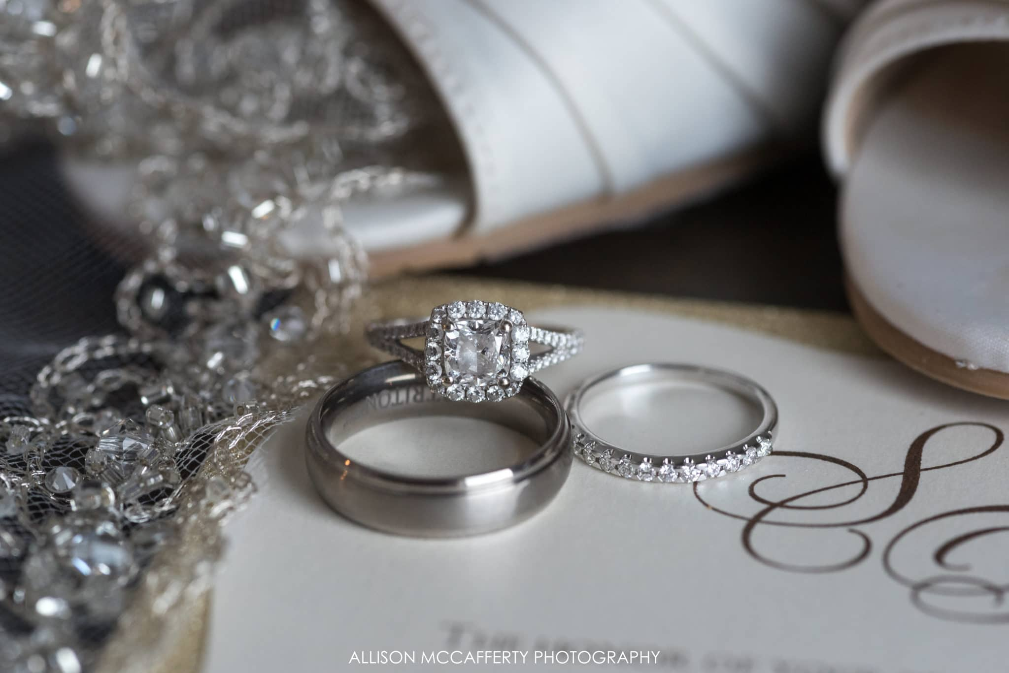 Wedding rings on top of invitation