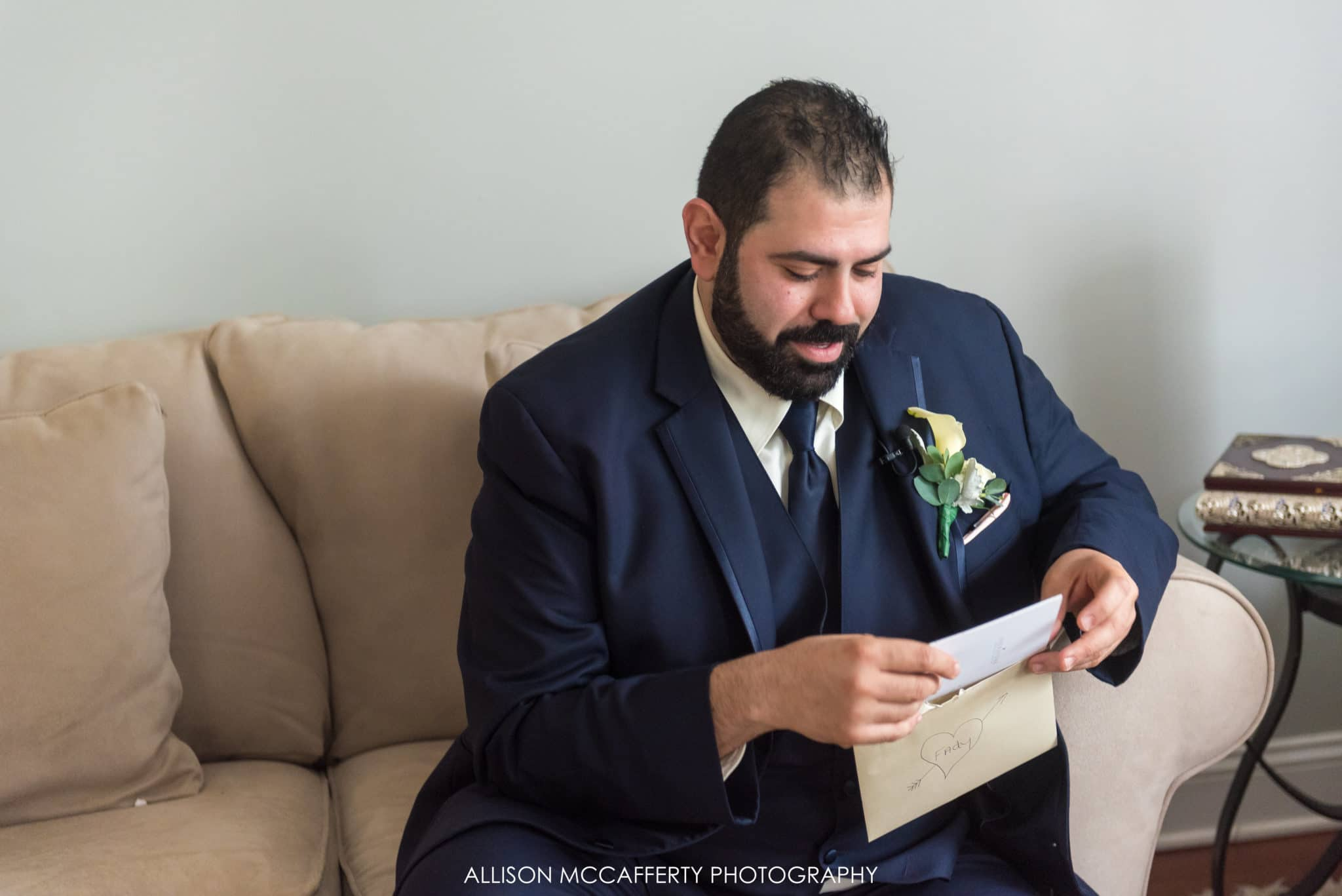 Groom reading a card from his bride to be