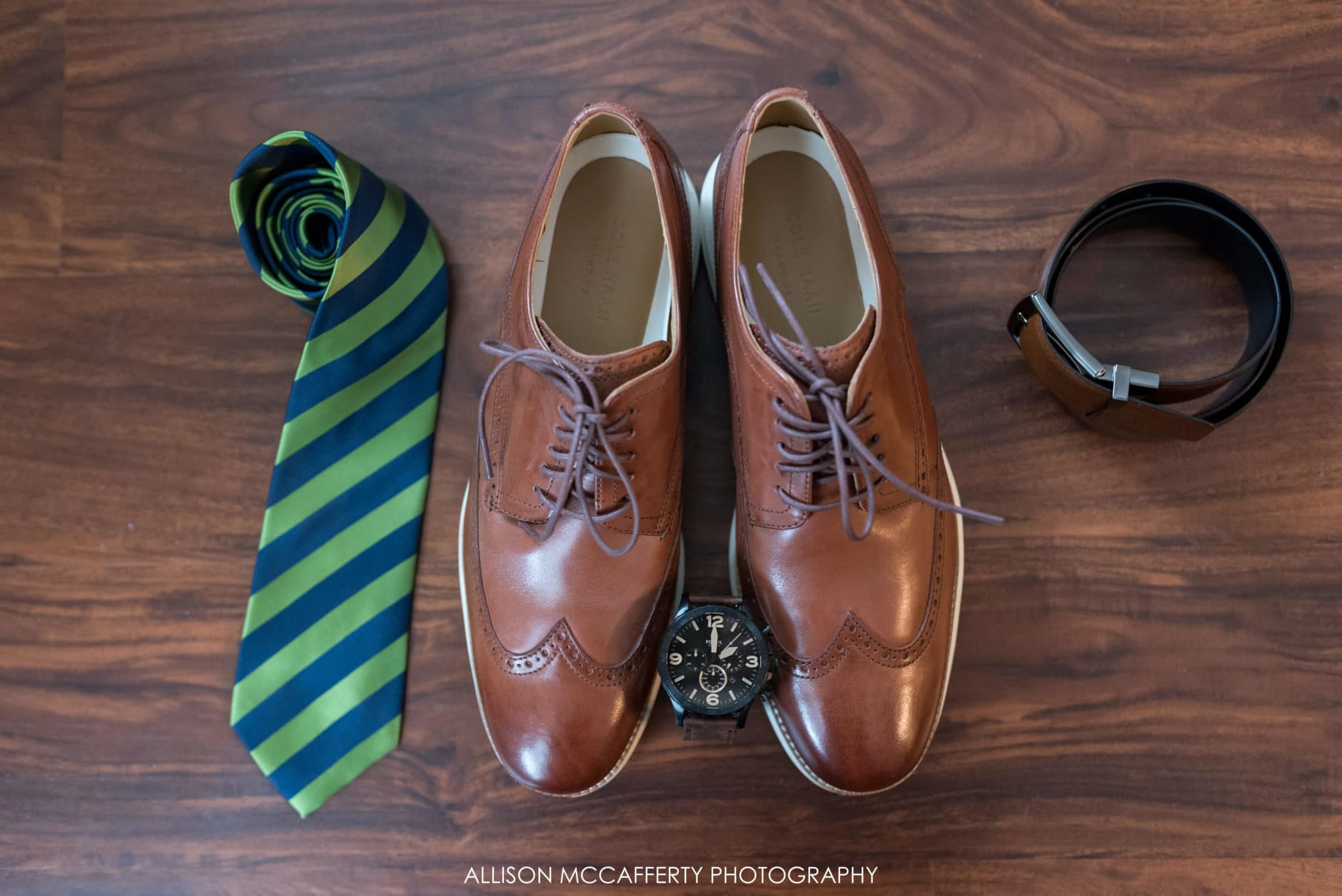 Groom prep photo of shoes and tie