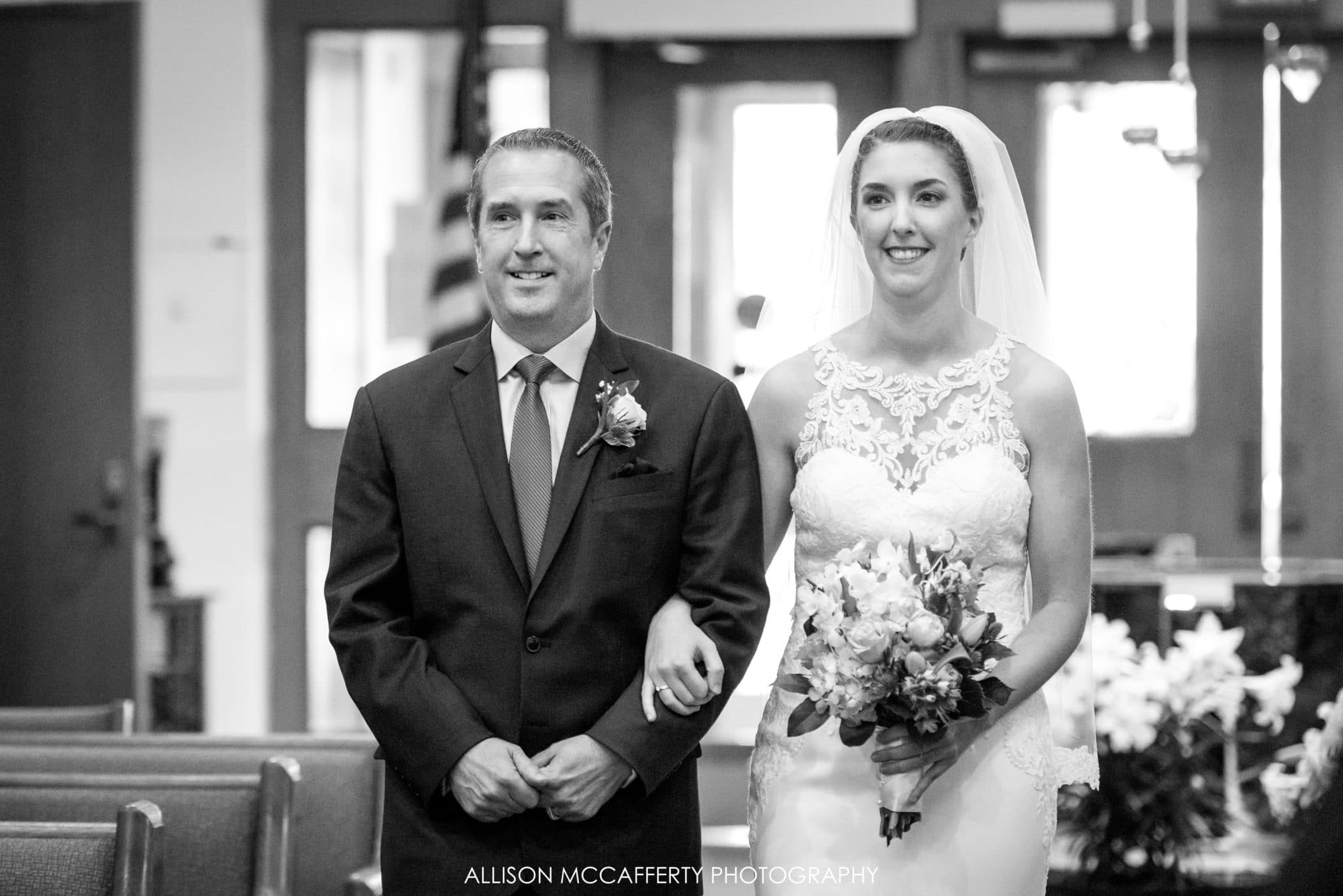 Father and daughter walking down the aisle on her wedding day.