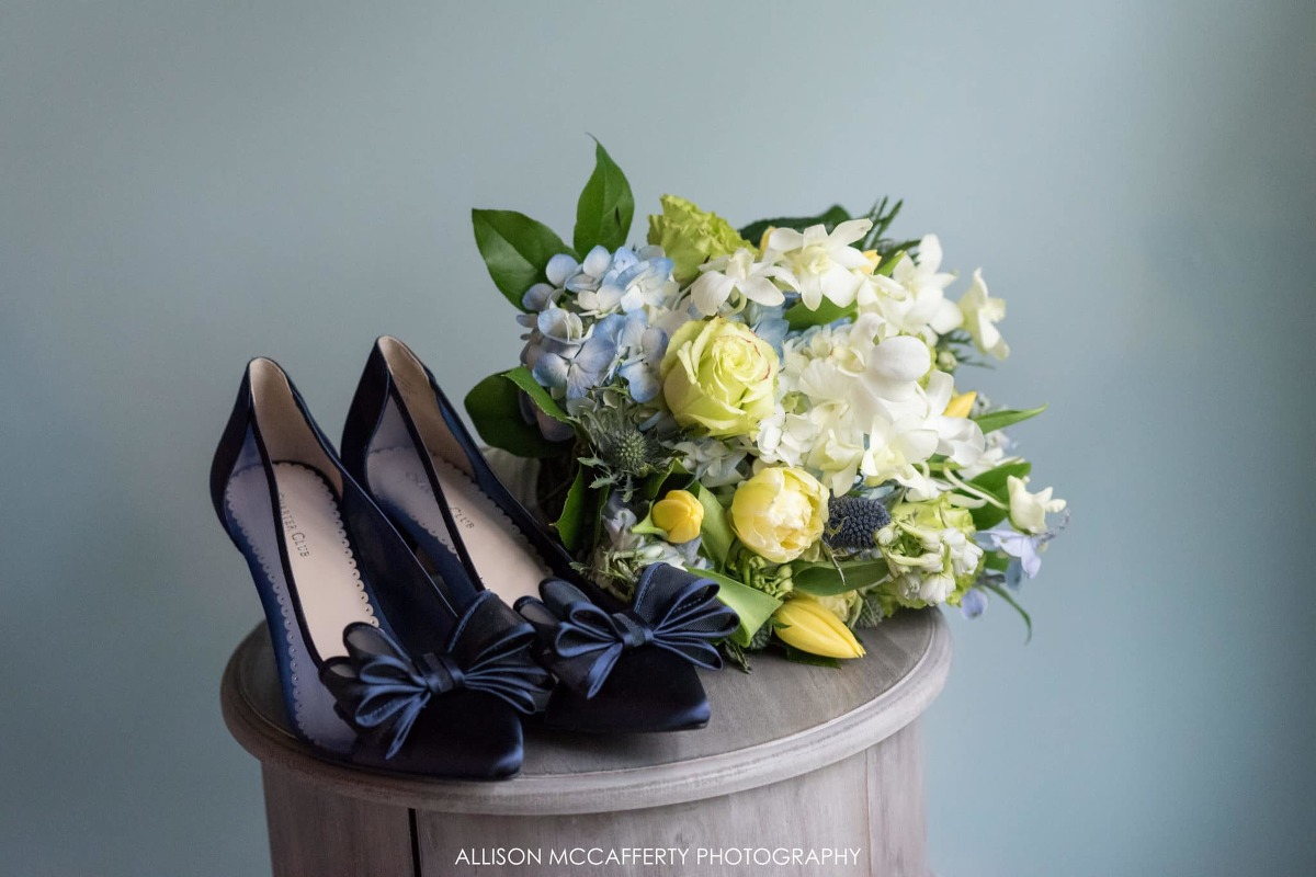 Blue wedding shoes and bouquet