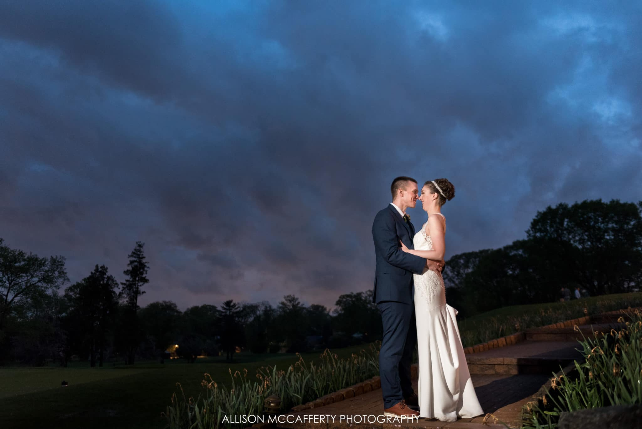 Portrait of bride and groom after the rain behind Tavistock Country Club