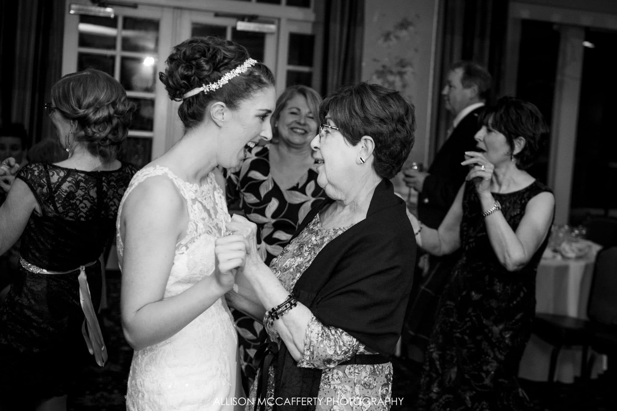 Bride and her grandmother dancing