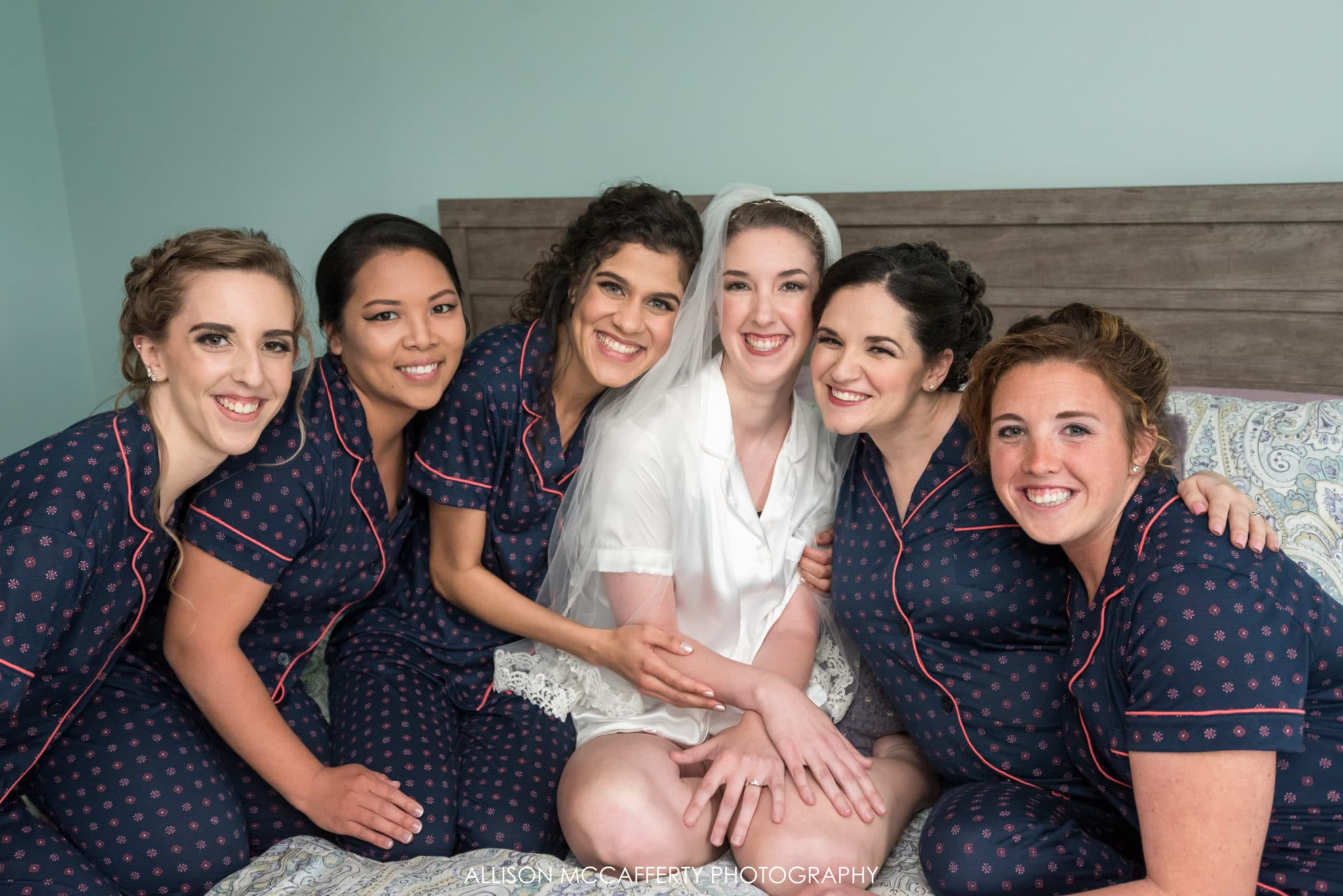 Bride and her bridesmaids in matching pjs