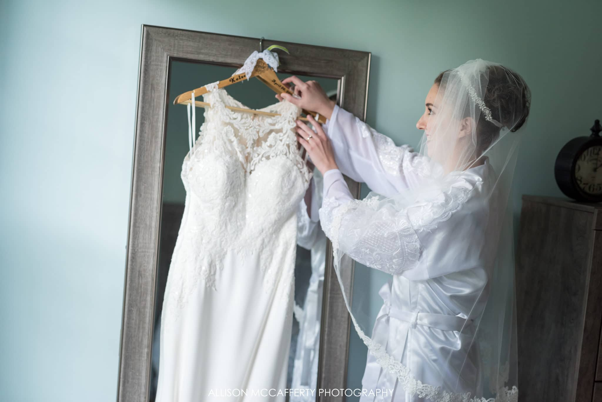 South Jersey bride touching her gown