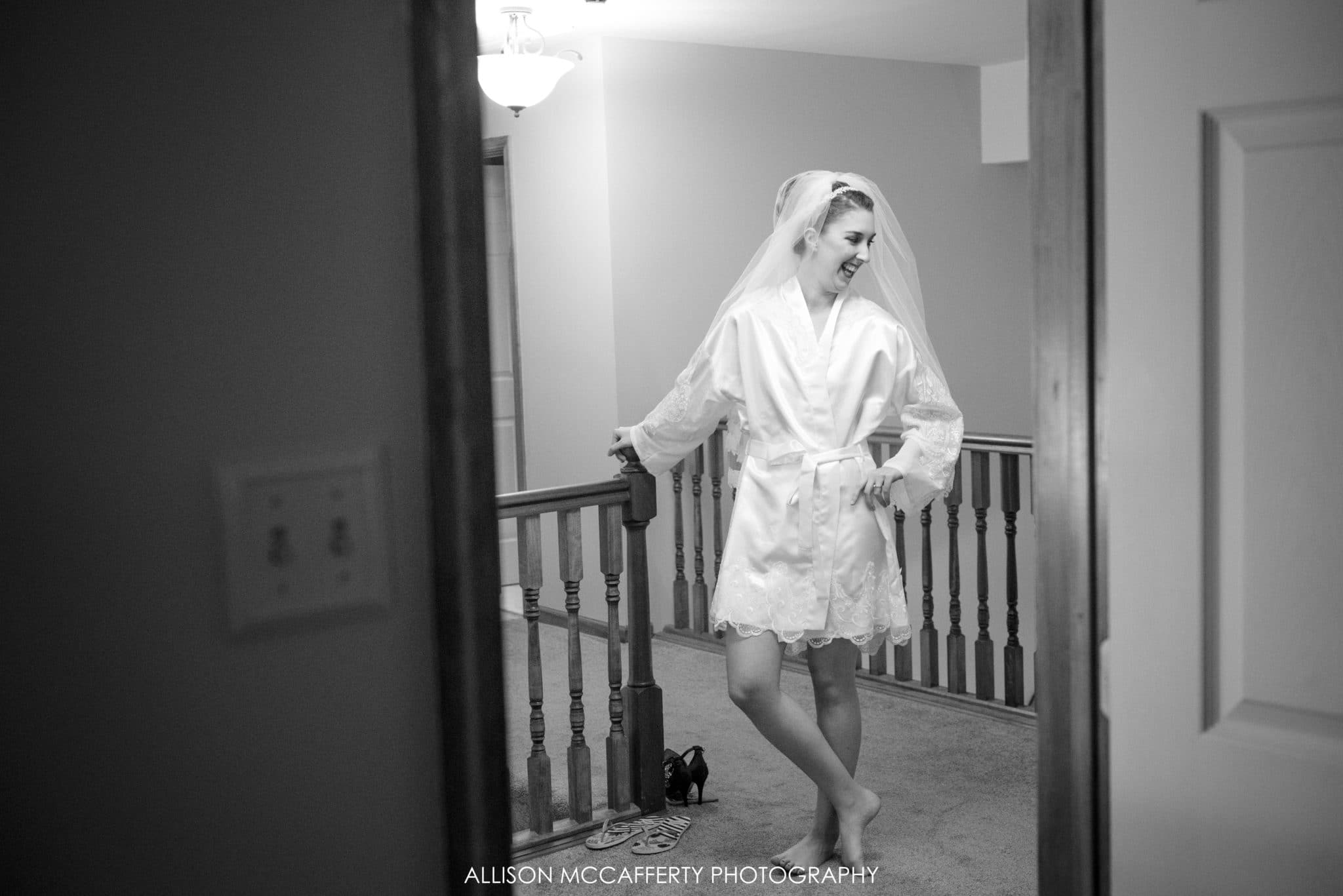 Black and white photo of bride waiting to get ready