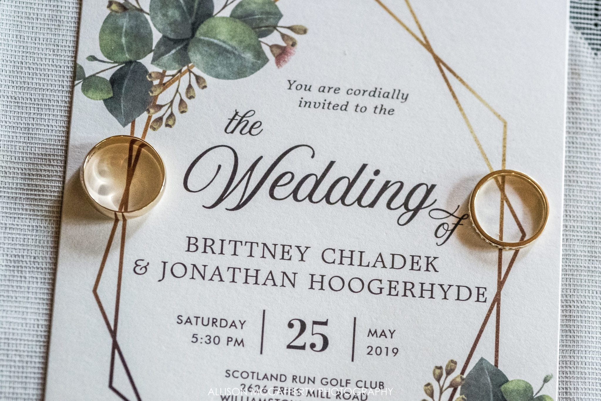 Wedding invitation with gold wedding rings