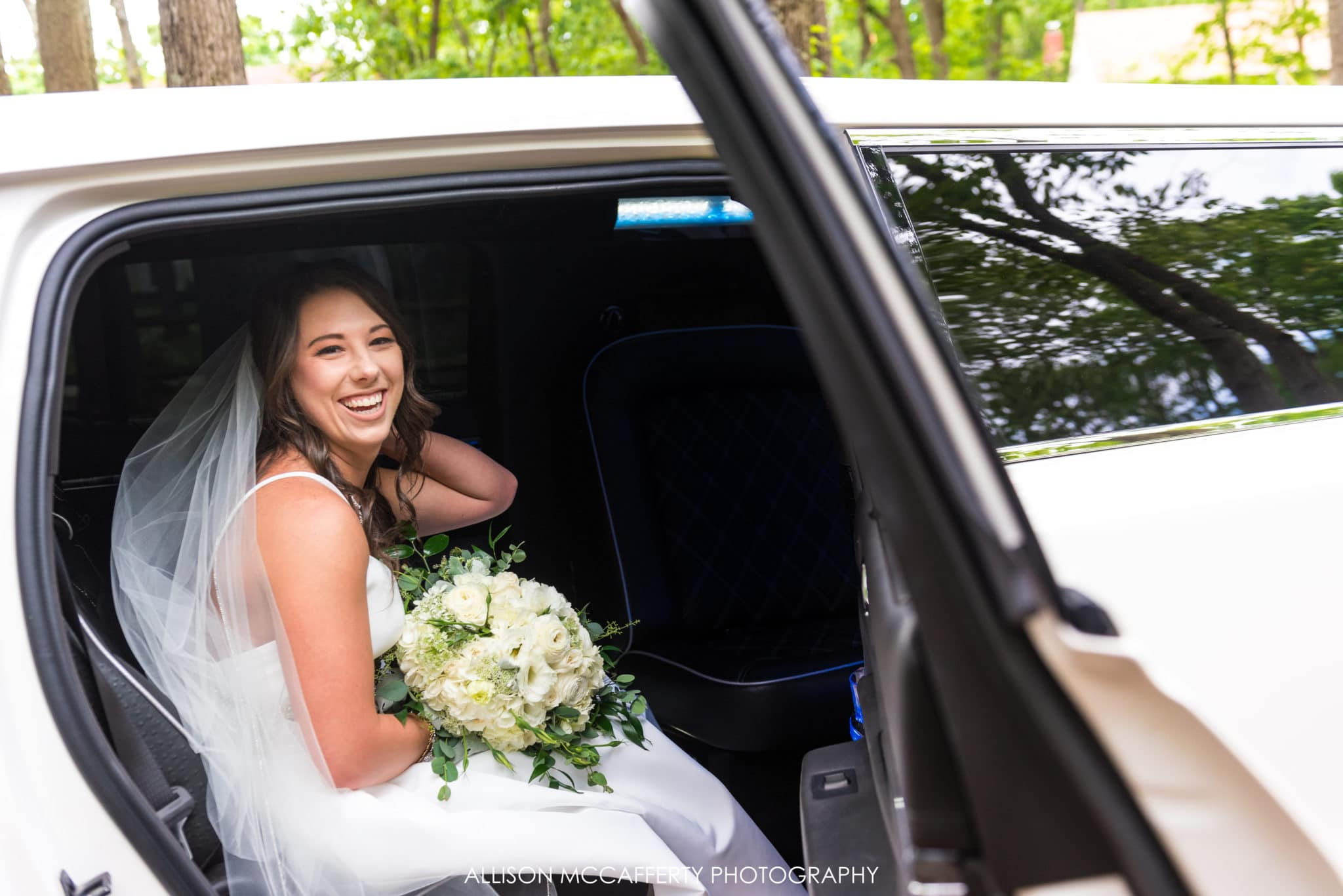 bride in limo before leaving for ceremony