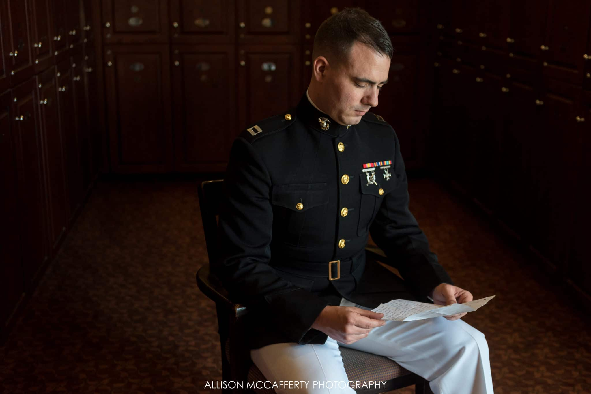 groom reading a letter from his bride in scotland run country club locker room