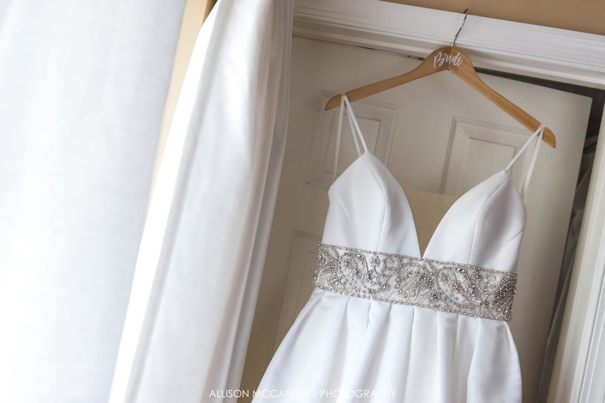 Wedding gown hanging by the window