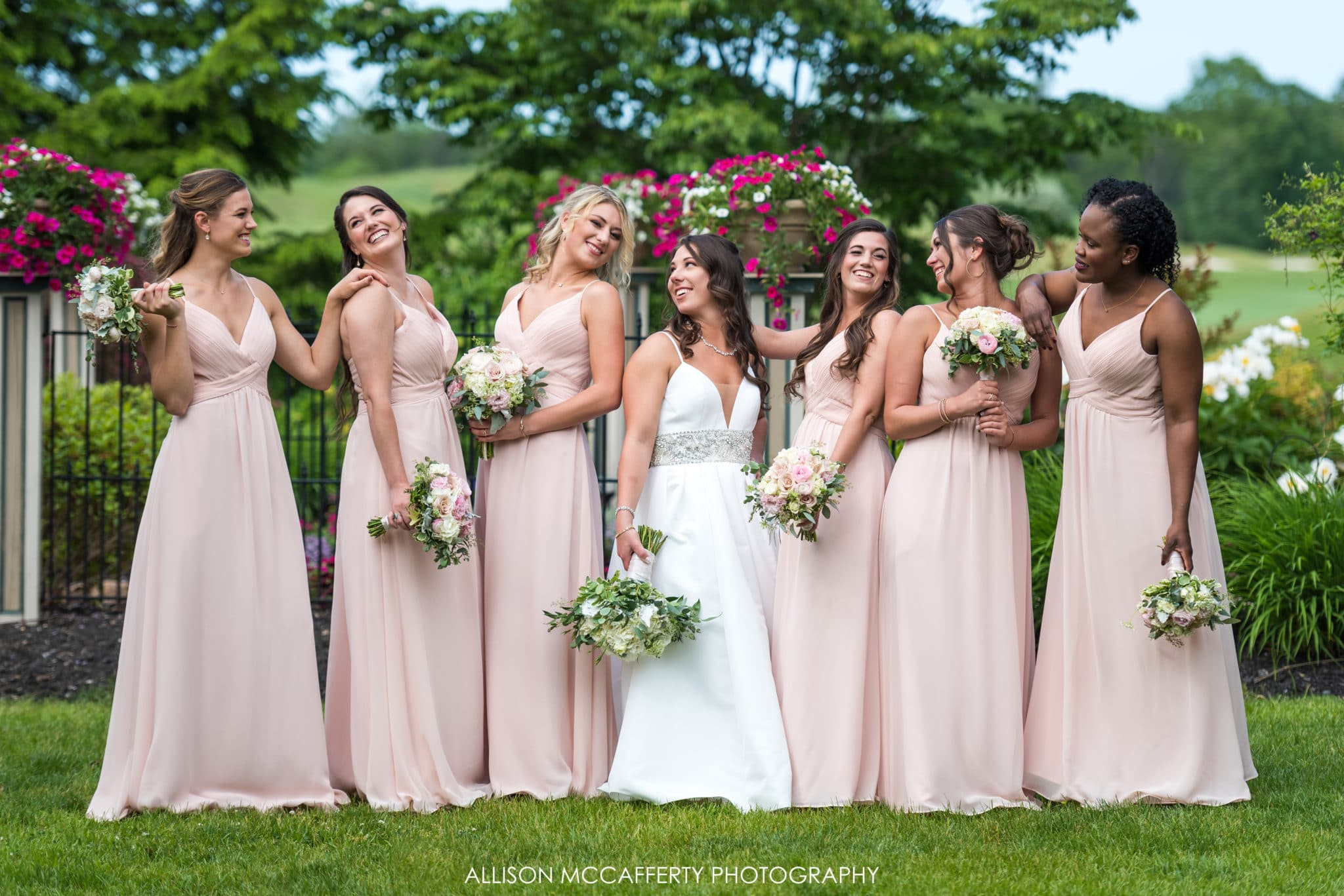 Bride and bridesmaids in the garden at Scotland Run Golf Club
