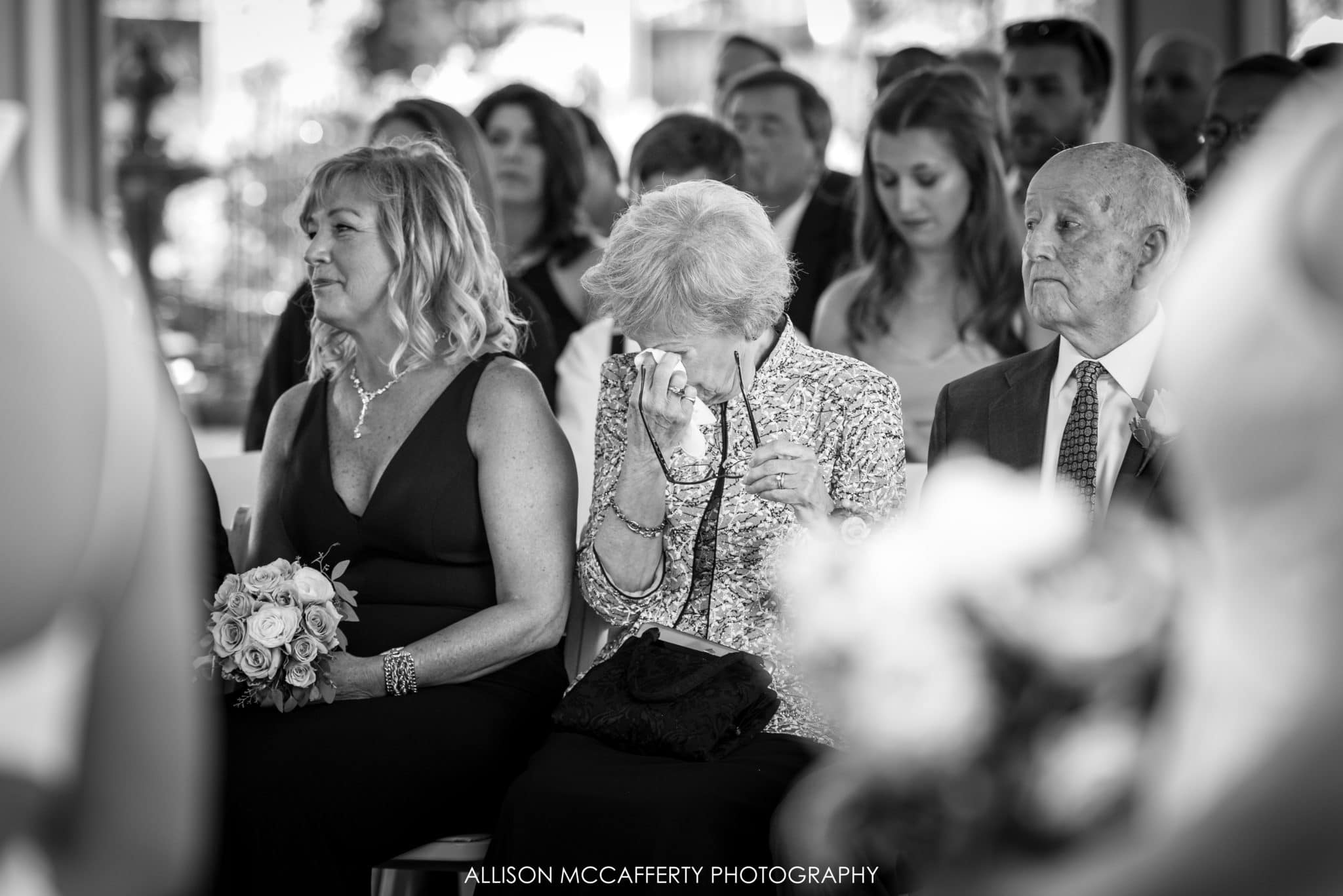 Grandmother crying during wedding ceremony