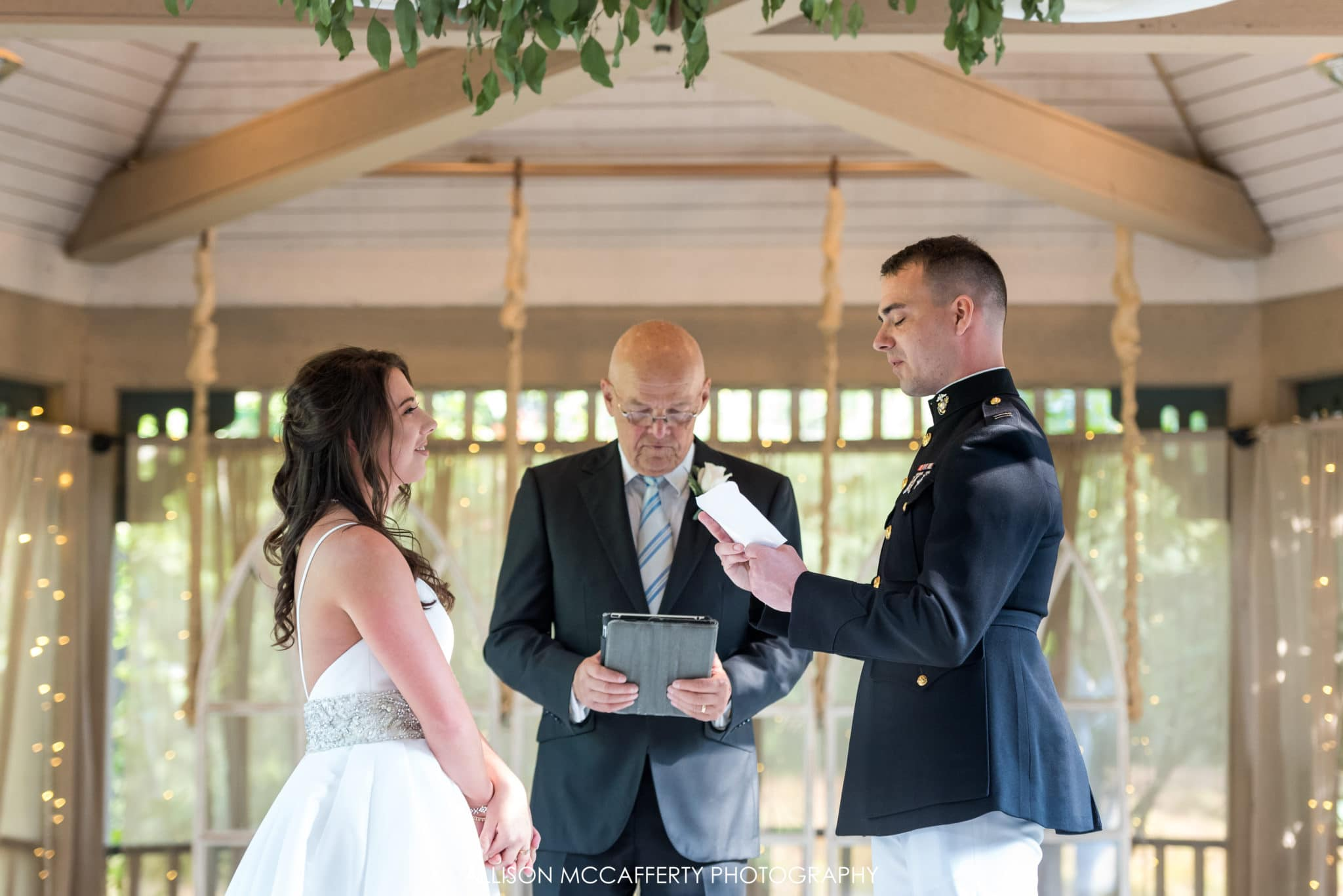 exchanging vows at the ceremony at Scotland Run