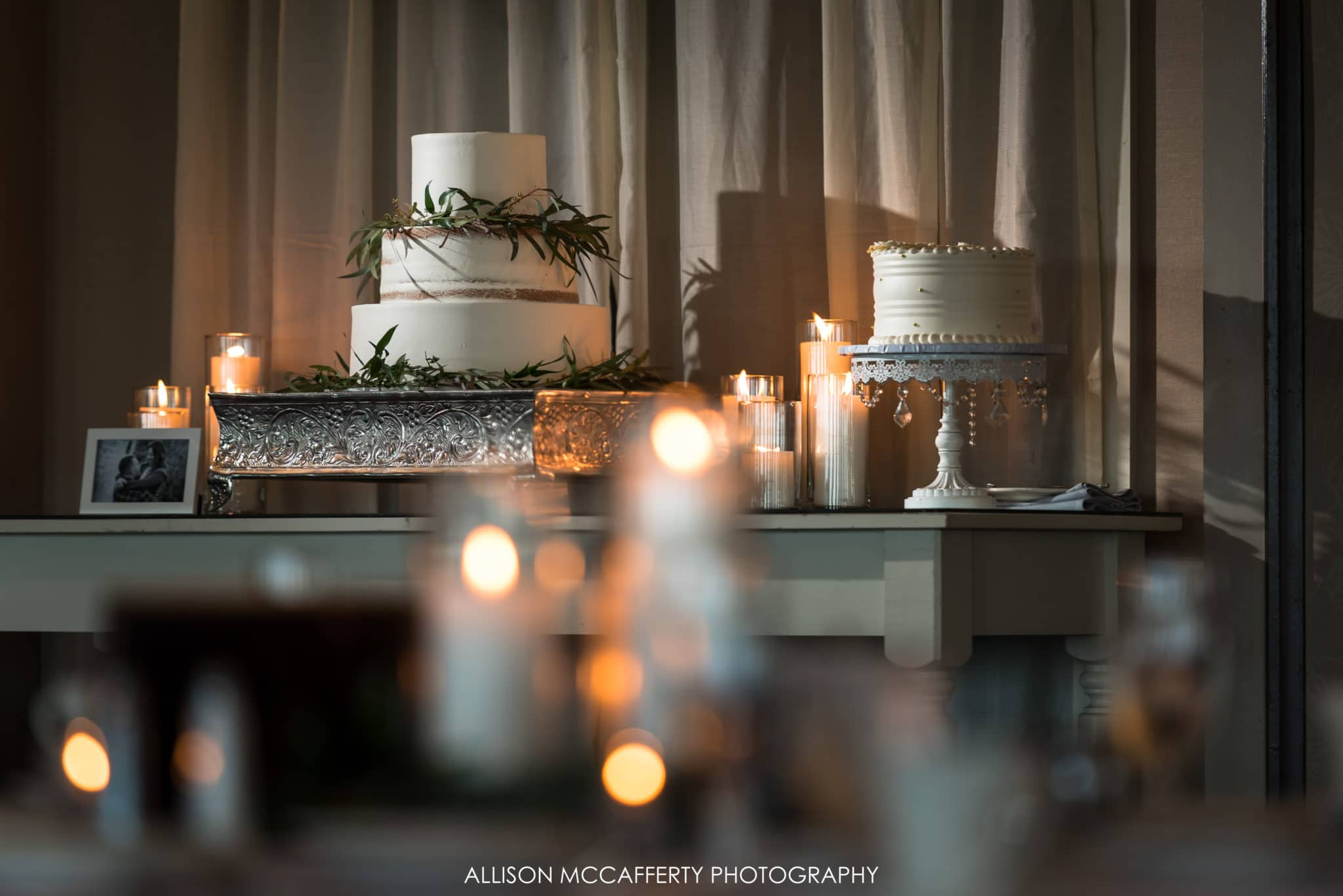 candles and wedding cake display