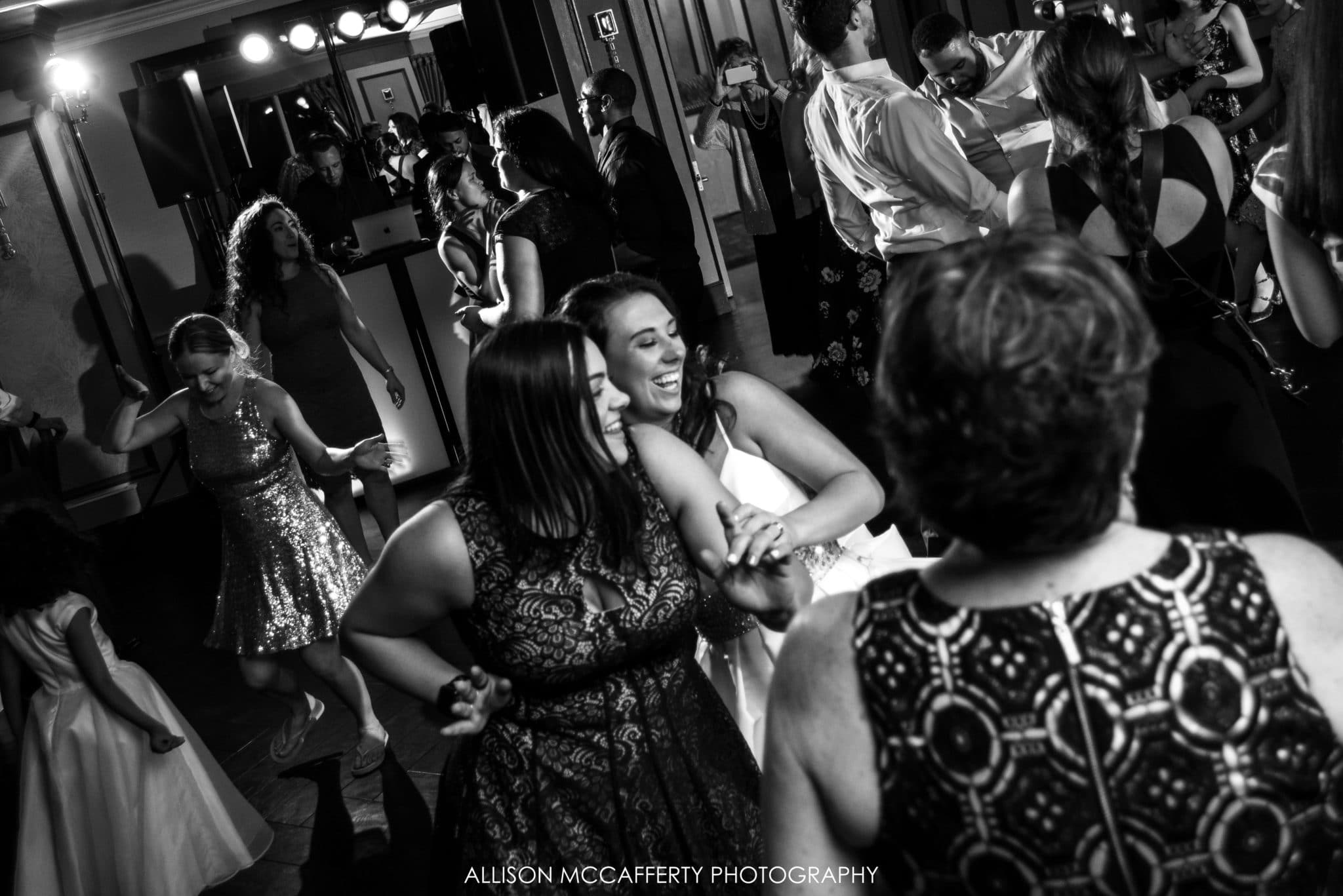 black and white photo of wedding reception dancing