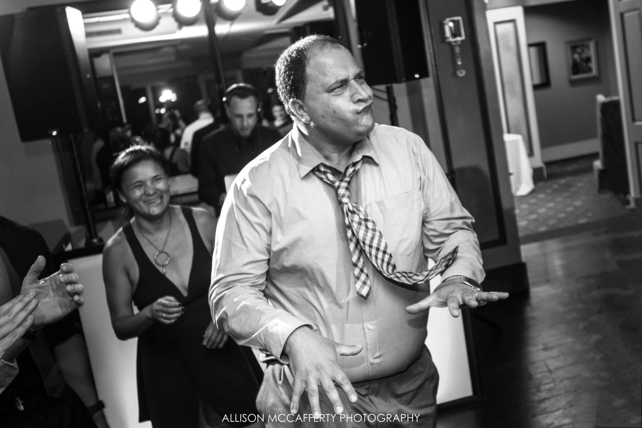 black and white dancing photo at a wedding