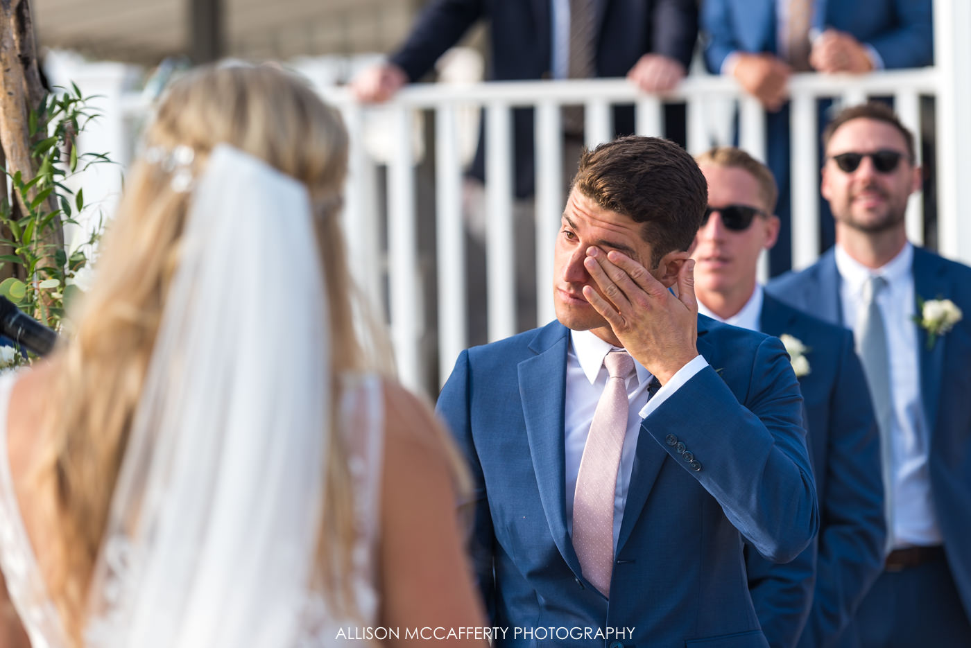 Groom crying during wedding ceremony at Brant Beach Yacht Club