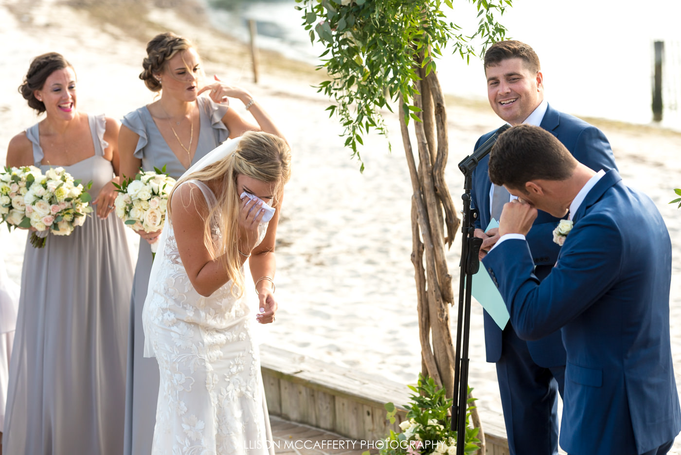 Bride and groom both crying during wedding ceremony in NJ