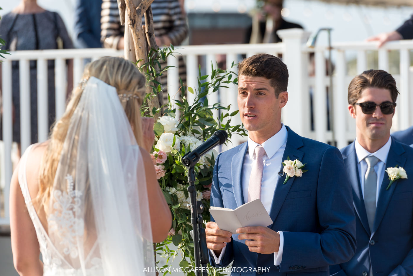 Groom reading his vows during an outdoor ceremony
