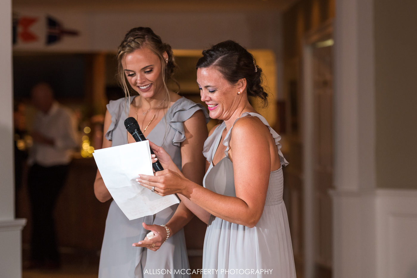 Maid and Matron of honor speaking during a wedding