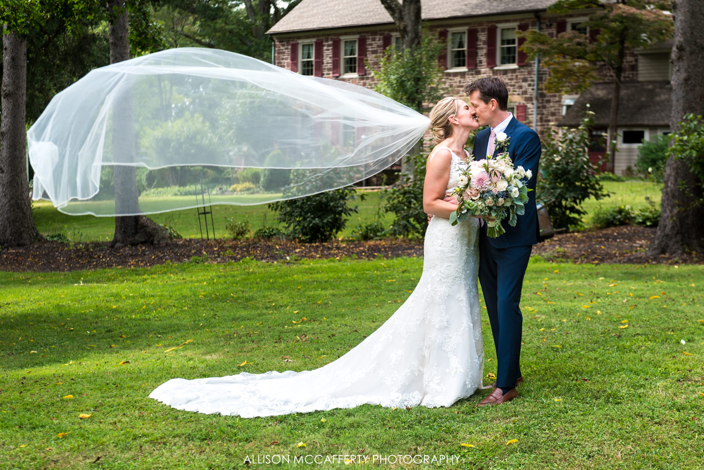 Wedding photo of bride with long veil floating in air