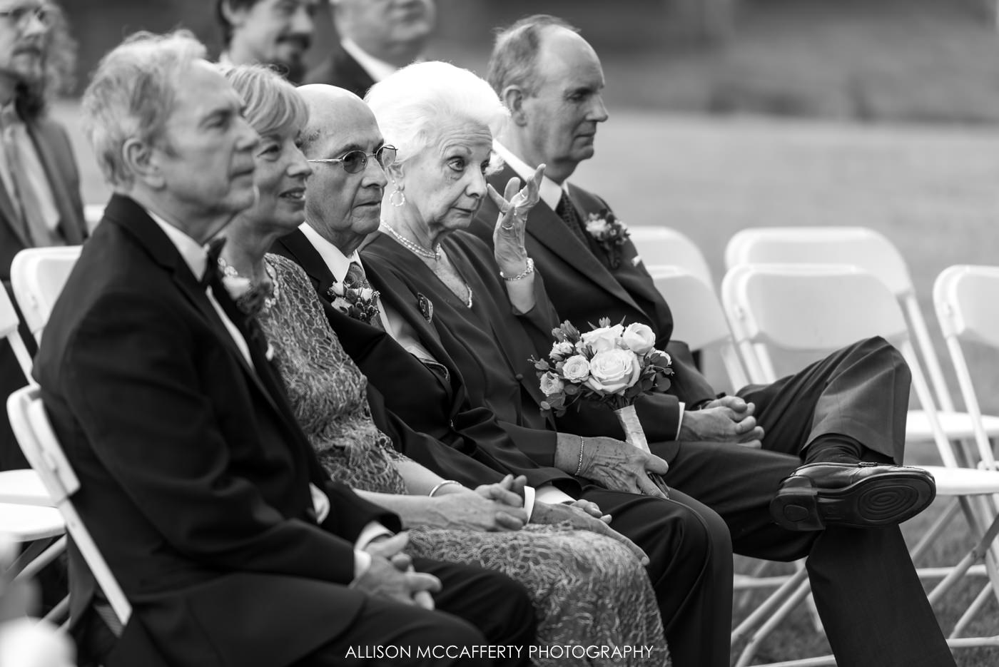 black and white photo of relative crying at wedding ceremony