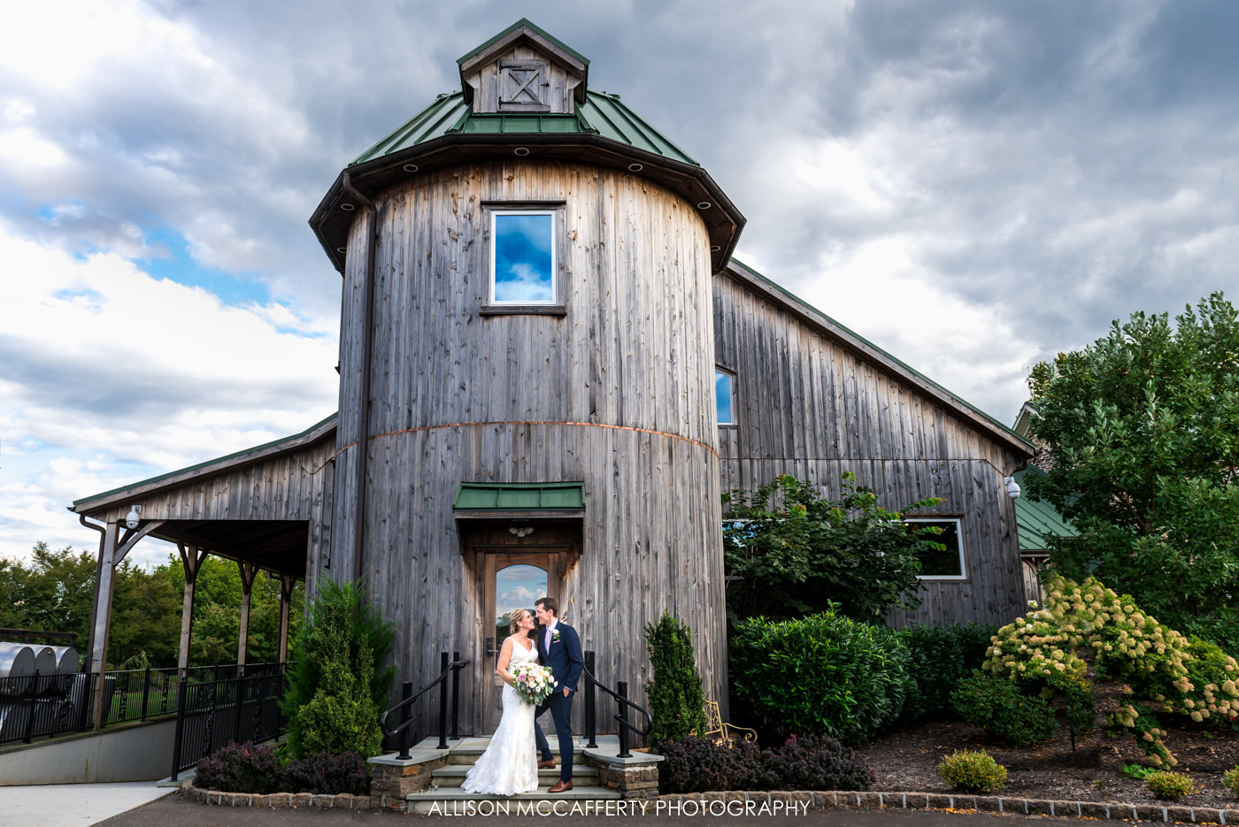 Wedding portrait in front of the silo at Rose Bank Winery